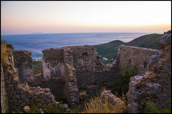 Overlooking Himare, Albania, the remains of a castle carved out of the hill and multiple churches carved out of the castle's remains. So Stendahl, no?